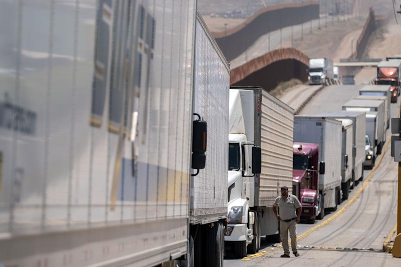 """Cargo truck drivers line up to cross to the United States at Otay commercial crossing port in Tijuana, Baja California state, on June 6, 2019, Mexico. - The US warned Mexico Thursday it needed to make more concessions on slowing migration to avoid President Donald Trump's threatened tariffs, as the Mexican leader announced he would visit the border to """"defend our dignity."""" (Photo by Guillermo Arias / AFP) (Photo credit should read GUILLERMO ARIAS/AFP/Getty Images)"""