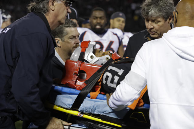 Raiders cornerback Gareon Conley leaves the game on a stretcher after taking an inadvertent leg to the helmet from his own teammate in their game against the Denver Broncos on Monday night. (AP/Ben Margot)