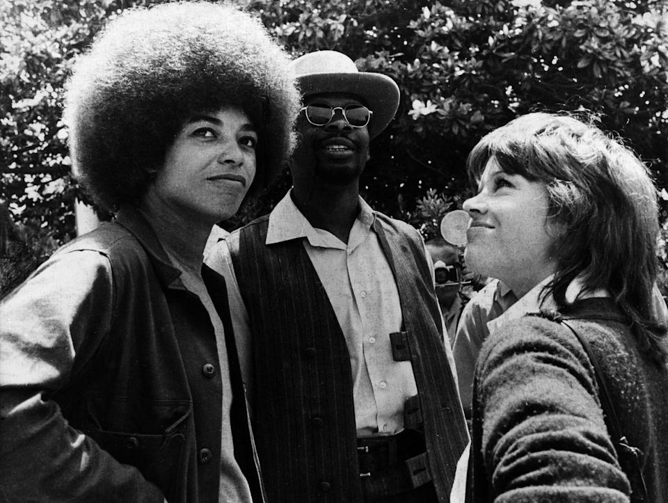 <p>Jane Fonda is seen with political activist Angela Davis (left) during a demonstration against the war in Vietnam on the University of Los Angeles's campus. </p>