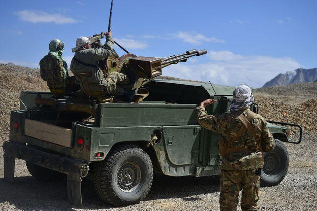 Afghan resistance movement and anti-Taliban uprising forces personnel patrol on an armoured humvee at an outpost in Kotal-e Anjuman of Paryan district in Panjshir province on August 23, 2021 (Photo: AHMAD SAHEL ARMAN via Getty Images)