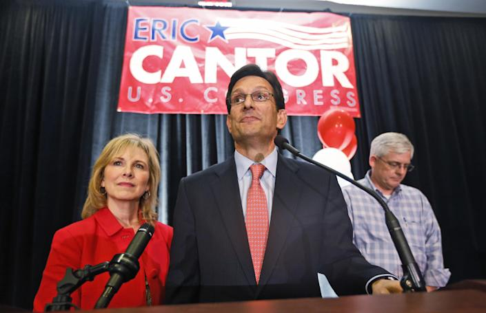 House Majority Leader Eric Cantor, R-Va., delivers his concession speech as his wife, Diana, listens in Richmond, Va., Tuesday, June 10, 2014. Cantor lost in the GOP primary tp tea party candidate Dave Brat. (AP Photo/Steve Helber)
