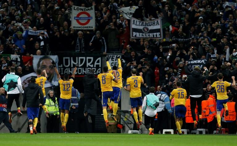 Juventus players celebrate in front of their supporters beating Tottenham 2-1 at Wembley, 4-3 on aggregate