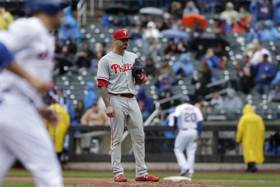 Philadelphia Phillies pitcher Vince Velasquez stands on the pitcher's mound as New York Mets Michael Conforto, left, rounds the bases with a three-run home run in the fifth inning of a baseball game, Sunday, Sept. 9, 2018, in New York. (AP Photo/Mark Lennihan)