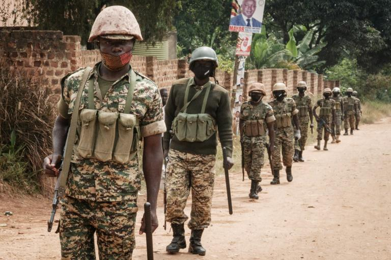Ugandan troops pictured on Monday near the street leading to Bobi Wine's home
