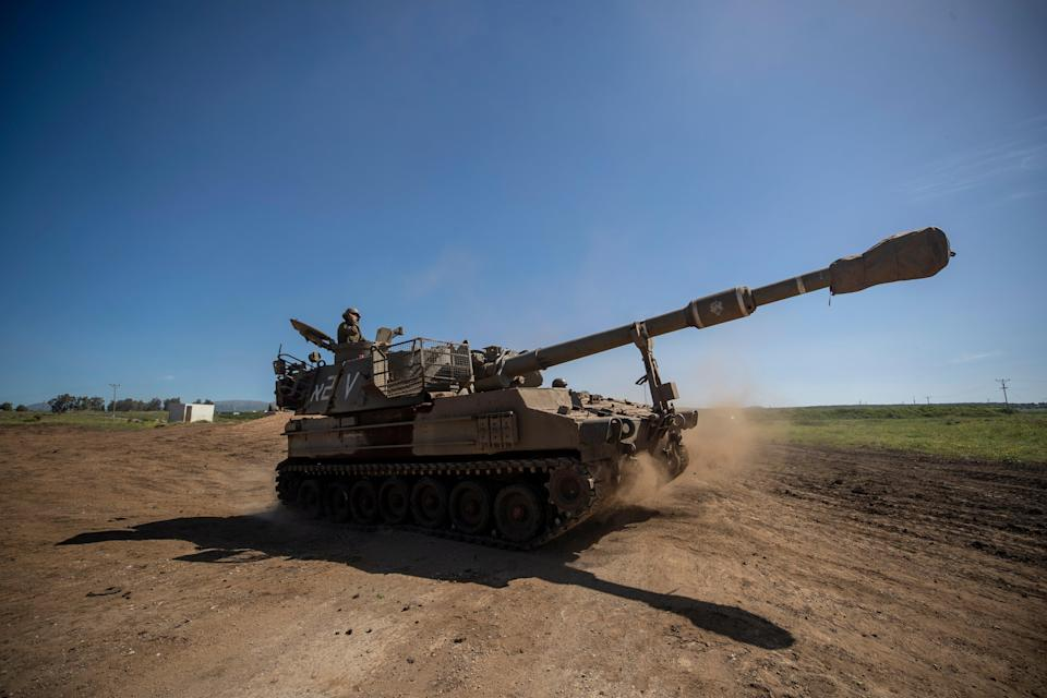 Israeli artillery unit deployed next to the Israeli-Syrian border on ThursdayEPA