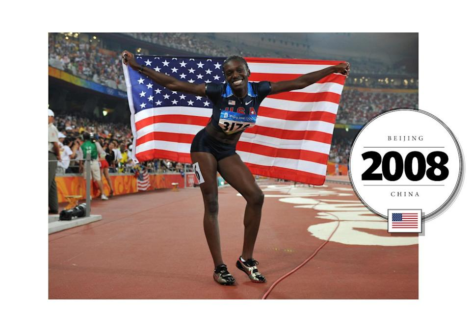 At her first Olympic Games in 2008, Dawn Harper won the Gold medal for the 100-meter hurdles. Her team USA uniform interestingly included this crop-top, polo shirt and short shorts. (Getty Images)