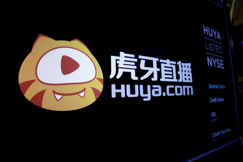 FILE PHOTO: The Huya logo is shown on the NYSE boards ahead of the company's IPO at the New York Stock Exchange (NYSE) in New York
