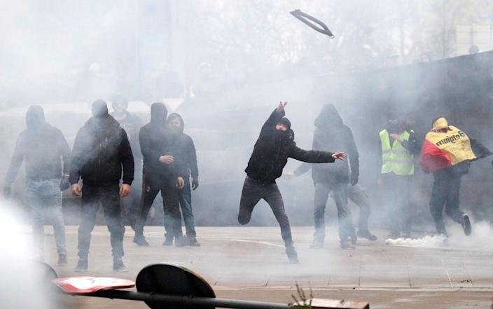 Far-right supporters threw objects during a protest against the Marrakesh Migration Pact - REUTERS