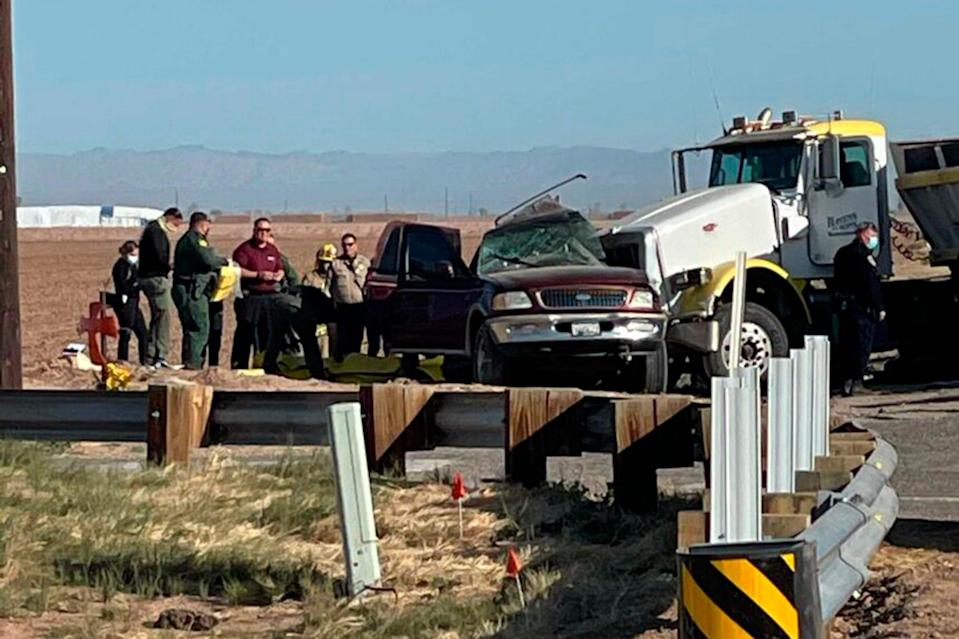 Law enforcement authorities work at the scene of a deadly crash involving a semitruck and an SUV in Holtville, California., on March 2.