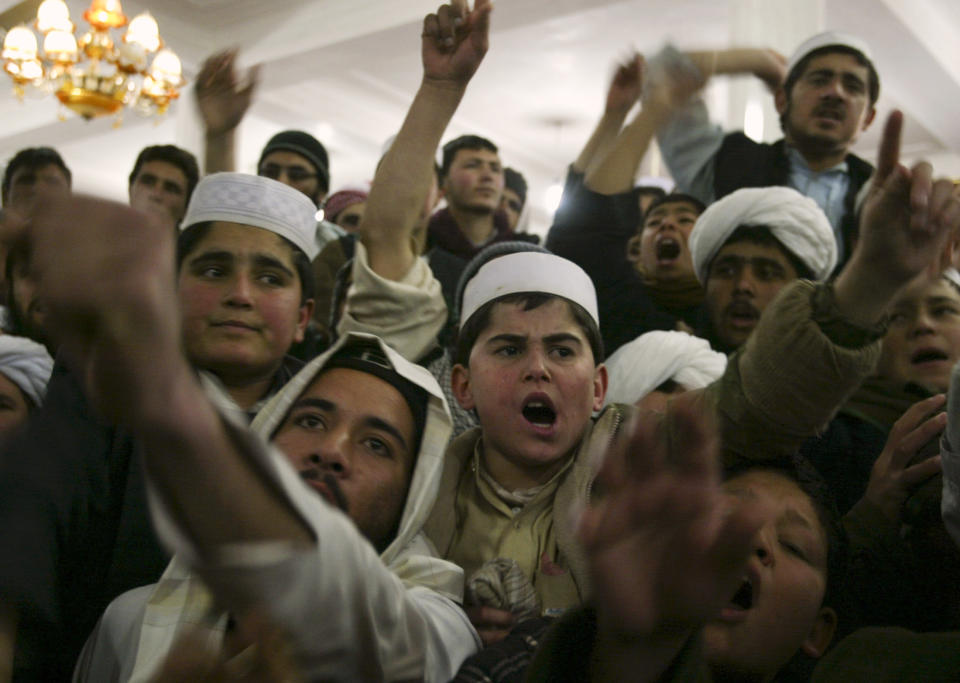 Afghan protesters shout anti-U.S. slogans during a protest at a mosque in the city of Herat February 23, 2012. An Afghan soldier joined protests on Thursday against the burning of copies of the Koran at a NATO base and shot dead two foreign troops, Western military sources said, as the Taliban urged security forces to turn their guns on foreigners. REUTERS/Mohammad Shoib (AFGHANISTAN - Tags: CIVIL UNREST RELIGION)