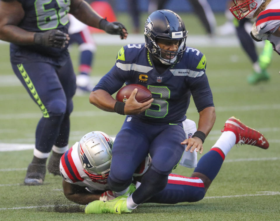 The initial audience for Russell Wilson and the Seattle Seahawks' win over the New England Patriots on Sunday night was down from Week 1's matchup. (Photo by Matthew J. Lee/The Boston Globe via Getty Images)