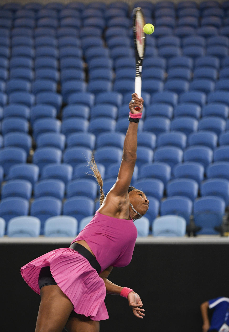 United States' Serena Williams serves to compatriot Danielle Collins during a tuneup event ahead of the Australian Open tennis championships in Melbourne, Australia, Friday, Feb. 5, 2021.(AP Photo/Andy Brownbill)