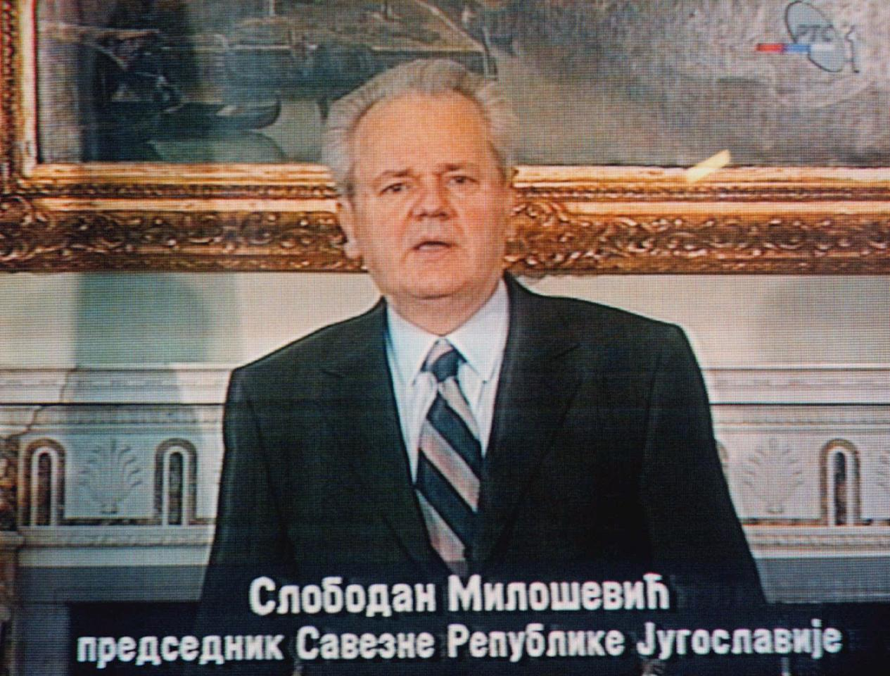 "FILE - In this March 24, 1999, file photo, taken from television, former Yugoslav President Slobodan Milosevic addresses the nation from Belgrade, Serbia. Caption at bottom translates, ""Slobodan Milosevic President of the Federal Republic of Yugoslavia."" NATO war planes were hitting tanks with deadly precision in Serbia, aiming to degrade a despot's army and empower the ragtag rebel force, which appears to echo the air strikes on the forces of Libyan leader Moammar Gadhafi, although in Libya there is no endgame in sight, yet."
