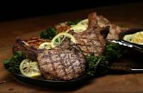 """<p>Pork chops are a weeknight staple, but skip the oven on those hot summer evenings and cook them on the grill. A lemon-garlic relish and steamed broccoli lighten this dish up, so you don't feel too heavy during those long nights.</p> <p><a href=""""https://www.thedailymeal.com/best-recipes/grilled-pork-chops-lemon-garlic-relish?referrer=yahoo&category=beauty_food&include_utm=1&utm_medium=referral&utm_source=yahoo&utm_campaign=feed"""" rel=""""nofollow noopener"""" target=""""_blank"""" data-ylk=""""slk:For the Smoky Grilled Pork Chops With Broccoli and Lemon-Garlic Relish recipe, click here."""" class=""""link rapid-noclick-resp"""">For the Smoky Grilled Pork Chops With Broccoli and Lemon-Garlic Relish recipe, click here.</a></p>"""