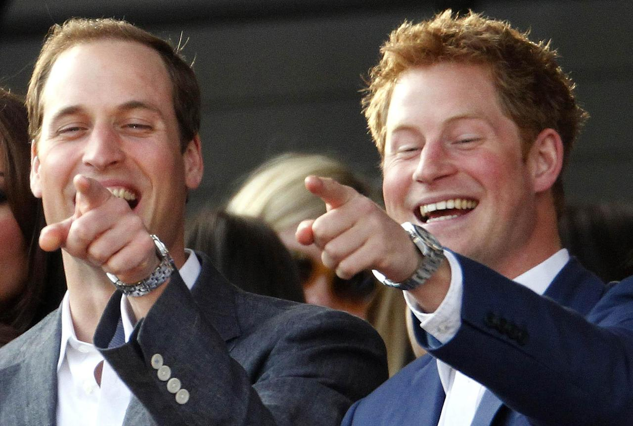 The Duke of Cambridge with his brother Prince Harry, right, point at something as they attend the Diamond Jubilee concert in London Monday June 4, 2012. Thousands of flag-waving fans gathered to watch British music royalty celebrate Queen Elizabeth II on Monday with a Buckingham Palace concert featuring acts from throughout her 60-year-reign. But the queen's husband, Prince Philip, missed the concert after being hospitalized with a bladder infection. (AP Photo / Dave Thompson, Pool)