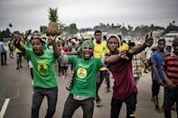 Ruling party supporters celebrate Magufuli's re-election, on the outskirts of Stone Town on Friday