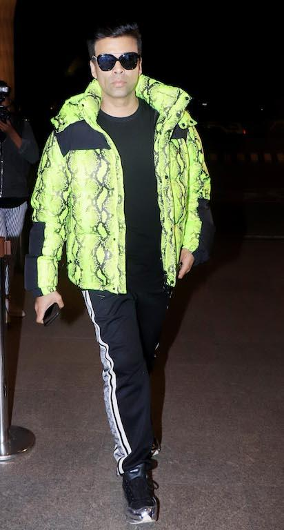 Karan Johar knows how to grab all the attention, this time in the form of a neon animal print puffer jacket.