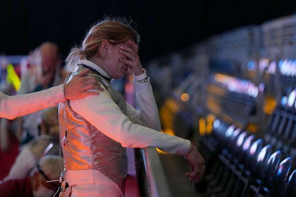 PHOTO: Flora Pasztor, of Hungary, cries after her team lost against Canada Foil team in the women's individual Foil classifications 5-8 competition at the 2020 Summer Olympics, Thursday, July 29, 2021, in Chiba, Japan. (Hassan Ammar/AP Photo)