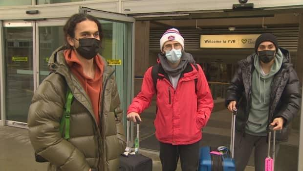 'I'm just here to go skiing and enjoy my time off,' said the traveller from Quebec on the left.