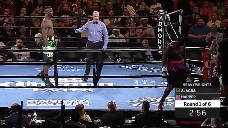 Boxer Curtis Harper walks out of ring at start of fight