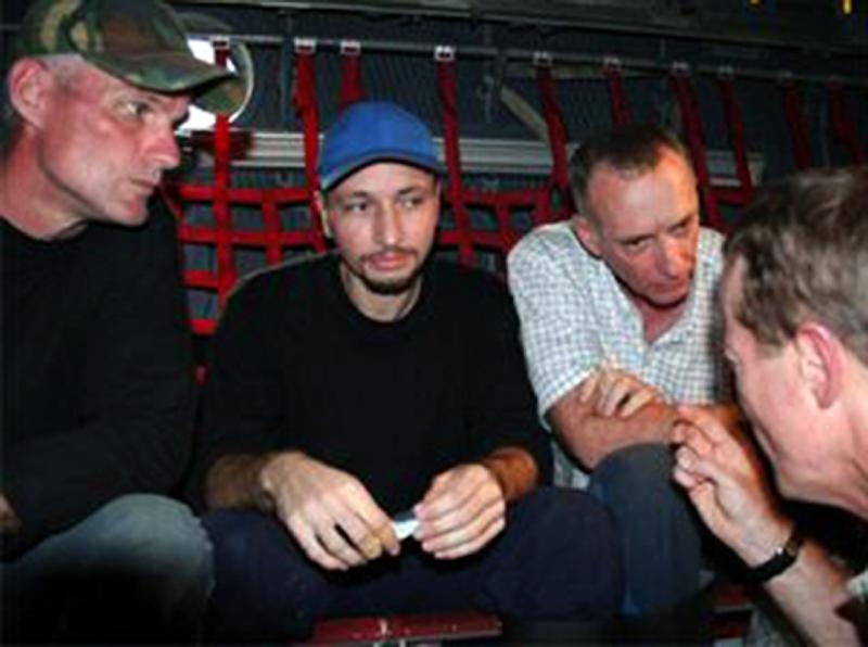 This image released by the US embassy in Colombia shows US contractors Keith Stansell (L), Marc Gonsalves and Thomas Howes (R) inside an aircraft in an unknown location in Colombia after being rescued by Colombia's Army on July 2, 2008
