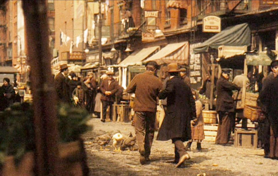 <p>The production team used vintage signs, cars, and props to make the street look authentic to 1918—they even managed to make the streets look unpaved. </p>