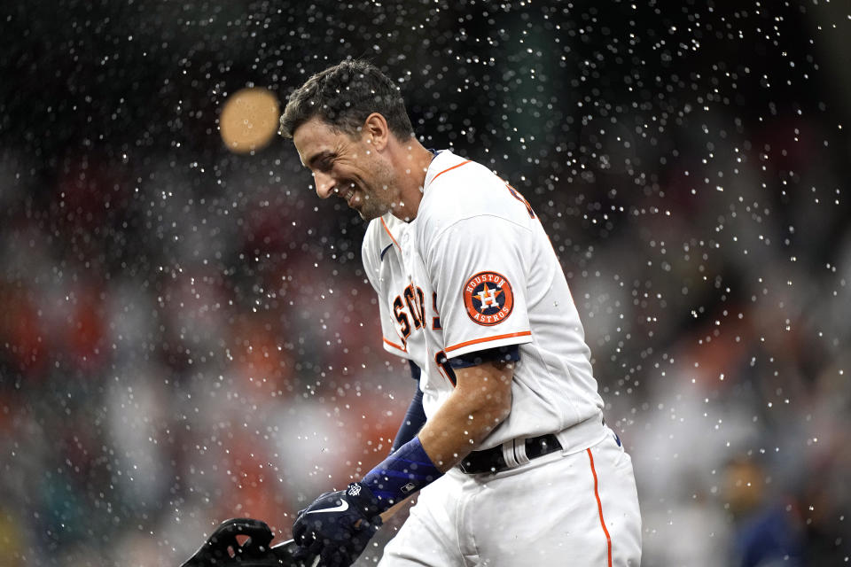 Houston Astros' Jason Castro celebrates after walking with the bases loaded to score Carlos Correa during the ninth inning of a baseball game against the Tampa Bay Rays Tuesday, Sept. 28, 2021, in Houston. The Astros won 4-3. (AP Photo/David J. Phillip)