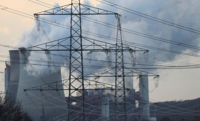 FILE PHOTO: Power lines are pictured in front of the Weisweiler lignite power plant of German utility and energy supplier RWE in Weisweiler near the western German city of Aachen