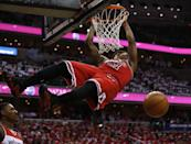 Chicago Bulls guard Jimmy Butler (21) dunks in front of Washington Wizards guard Bradley Beal in the first half of Game 3 of an opening-round NBA basketball playoff series on Friday, April 25, 2014, in Washington. (AP Photo/Alex Brandon)