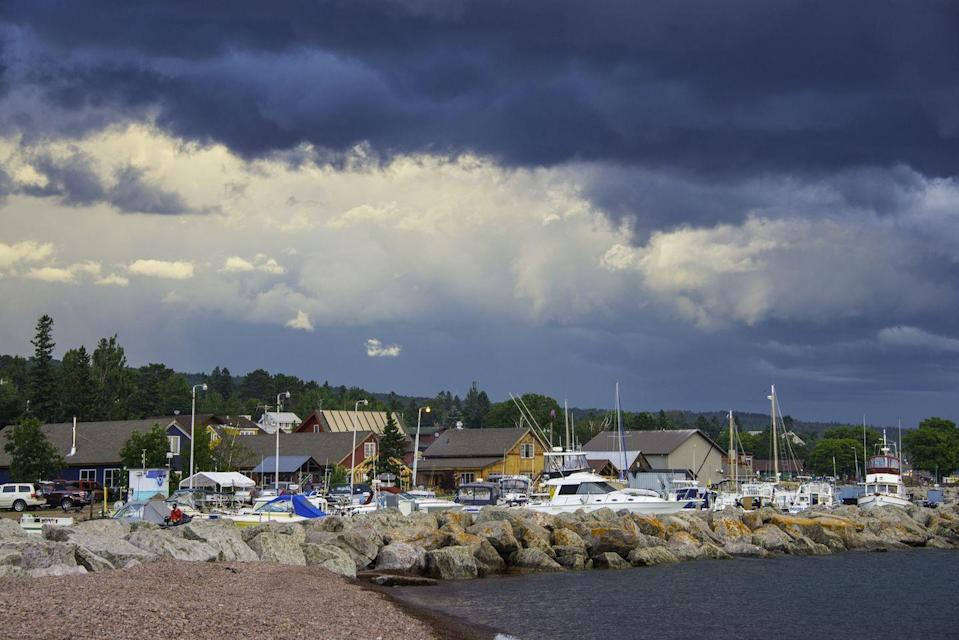 "<p>Another classic summer destination, Grand Marais is nestled close to the Sawtooth Mountains and Lake Superior. However, plenty call this lovely town ""home"" year-round, from <a href=""http://www.visitcookcounty.com/communities/grand-marais/"" rel=""nofollow noopener"" target=""_blank"" data-ylk=""slk:artists to otters"" class=""link rapid-noclick-resp"">artists to otters</a>. Grand Marais has also been inspiring <a href=""http://www.cbc.ca/superiormorning/episodes/2013/07/23/a-cultural-evolution-in-grand-marais/"" rel=""nofollow noopener"" target=""_blank"" data-ylk=""slk:young creatives"" class=""link rapid-noclick-resp"">young creatives</a> to settle down, resulting in a boom of interesting shops, restaurants and businesses.</p>"