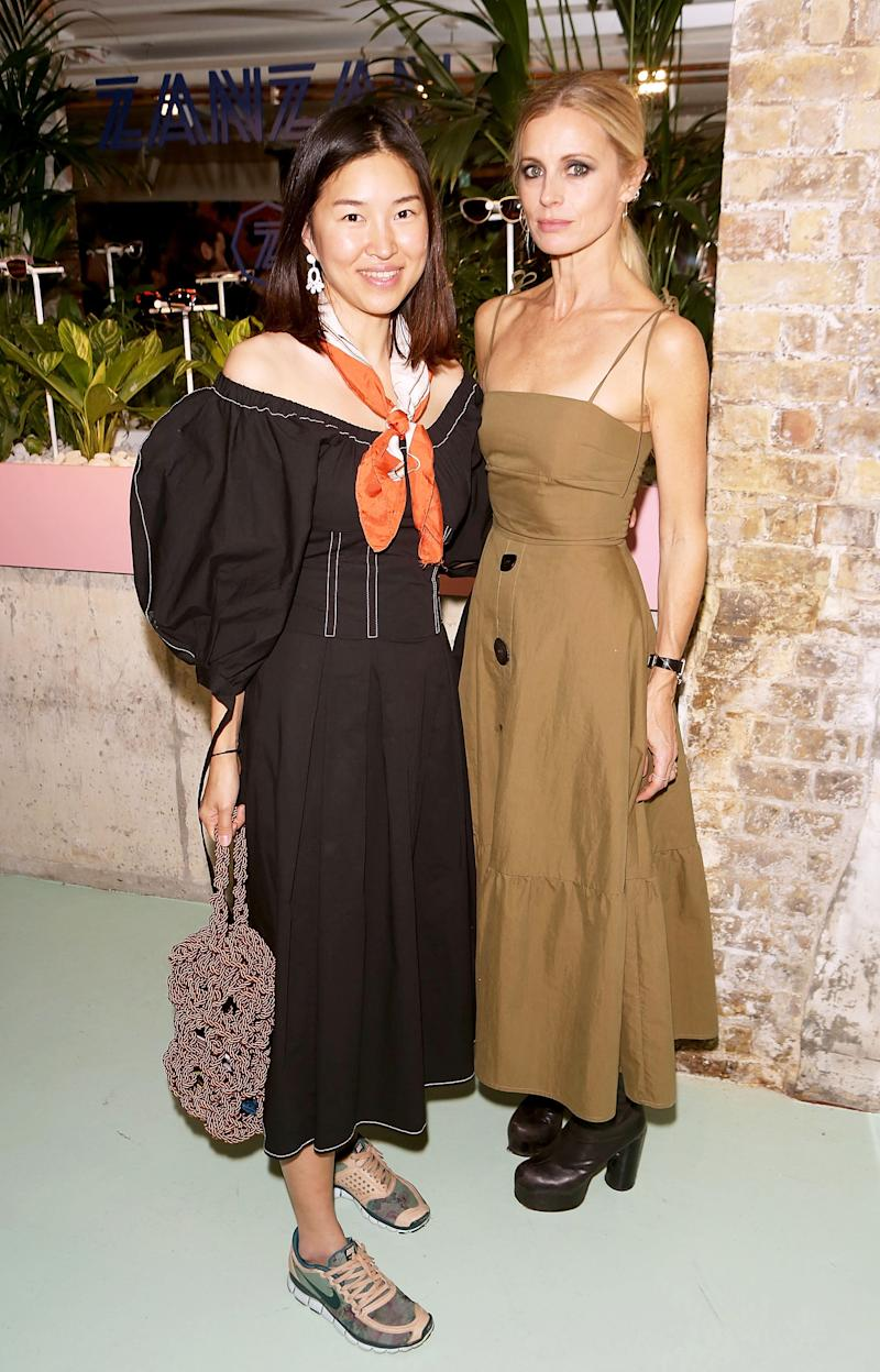 Rejina Pyo and British model/writer Laura Bailey at a cocktail party in London in November 2017 [Photo: Getty]