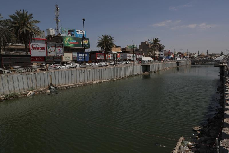 In this Saturday, July, 20, 2019 photo, wastewater flows in central Basra, Iraq. A leading human rights organization has accused Iraqi authorities of failing to properly address underlying causes for an ongoing water crisis in Iraq's southern region. A report issued Monday by Human Rights Watch on the chronic water shortages and pollution in Iraq's Basra province says authorities continue to allow activities that pollute Basra's water resources despite the health risks to residents. (AP Photo/Nabil al-Jurani)