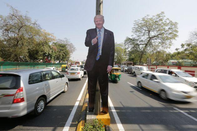 A life size cut-out of U.S. president Donald Trump on a road divider, ahead of his visit in Ahmedabad, India, Saturday, February 22, 2020.