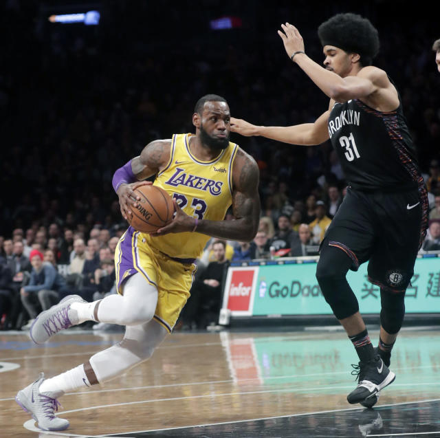 LeBron James drives past the Nets' Jarrett Allen (31) during the first half on Tuesday night. (AP)