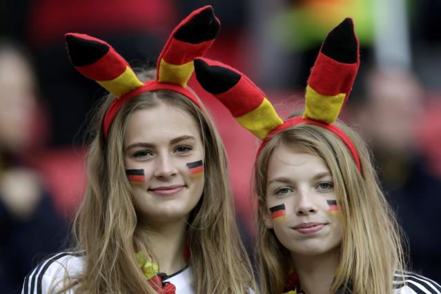 Fans pose before the start of the 2014 World Cup round of 16 game between Germany and Algeria at the Beira Rio stadium in Porto Alegre June 30, 2014. REUTERS/Henry Romero (BRAZIL - Tags: SOCCER SPORT WORLD CUP)