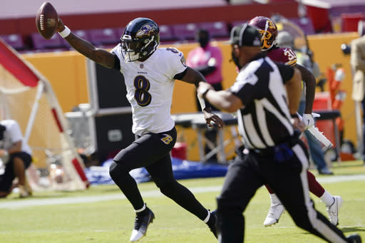Baltimore Ravens quarterback Lamar Jackson (8) runs to the end zone for a touchdown against the Washington Football Team during the first half of an NFL football game, Sunday, Oct. 4, 2020, in Landover, Md. (AP Photo/Susan Walsh)