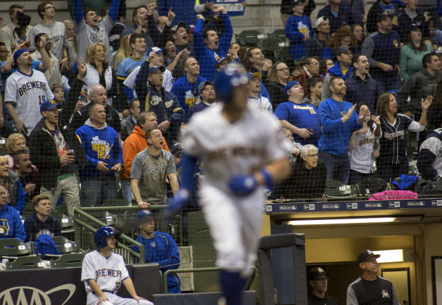 Fans cheer after Milwaukee Brewers' Travis Shaw, foreground, hit a solo home run against the Miami Marlins during the fourth inning of a baseball game Friday, April 20, 2018, in Milwaukee. (AP Photo/Darren Hauck)