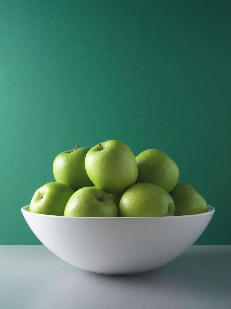 """<p>And set out a giant fruit bowl instead — you'll be more likely to reach for an apple or a banana. There really is something to the old adage """"Out of sight, out of mind,"""" according to <strong>Dawn Jackson Blatner, R.D.N.</strong>, author of <em><a href=""""https://www.amazon.com/Superfood-Swap-Without-C-R-P/dp/0544535553?tag=syn-yahoo-20&ascsubtag=%5Bartid%7C2089.g.35650177%5Bsrc%7Cyahoo-us"""" rel=""""nofollow noopener"""" target=""""_blank"""" data-ylk=""""slk:The Superfood Swap"""" class=""""link rapid-noclick-resp"""">The Superfood Swap</a></em>. In your pantry, move <a href=""""https://www.goodhousekeeping.com/food-recipes/healthy/g607/quinoa-recipes/"""" rel=""""nofollow noopener"""" target=""""_blank"""" data-ylk=""""slk:healthy staples like quinoa"""" class=""""link rapid-noclick-resp"""">healthy staples like quinoa</a>, nuts, and canned beans to the front of shelves at eye level and put less healthy snacks and sweets on a high shelf.</p>"""
