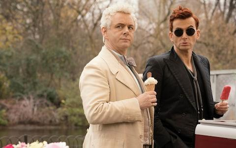 Michael Sheen as Aziraphale, with David Tennant as Crowley - Credit: Chris Raphael
