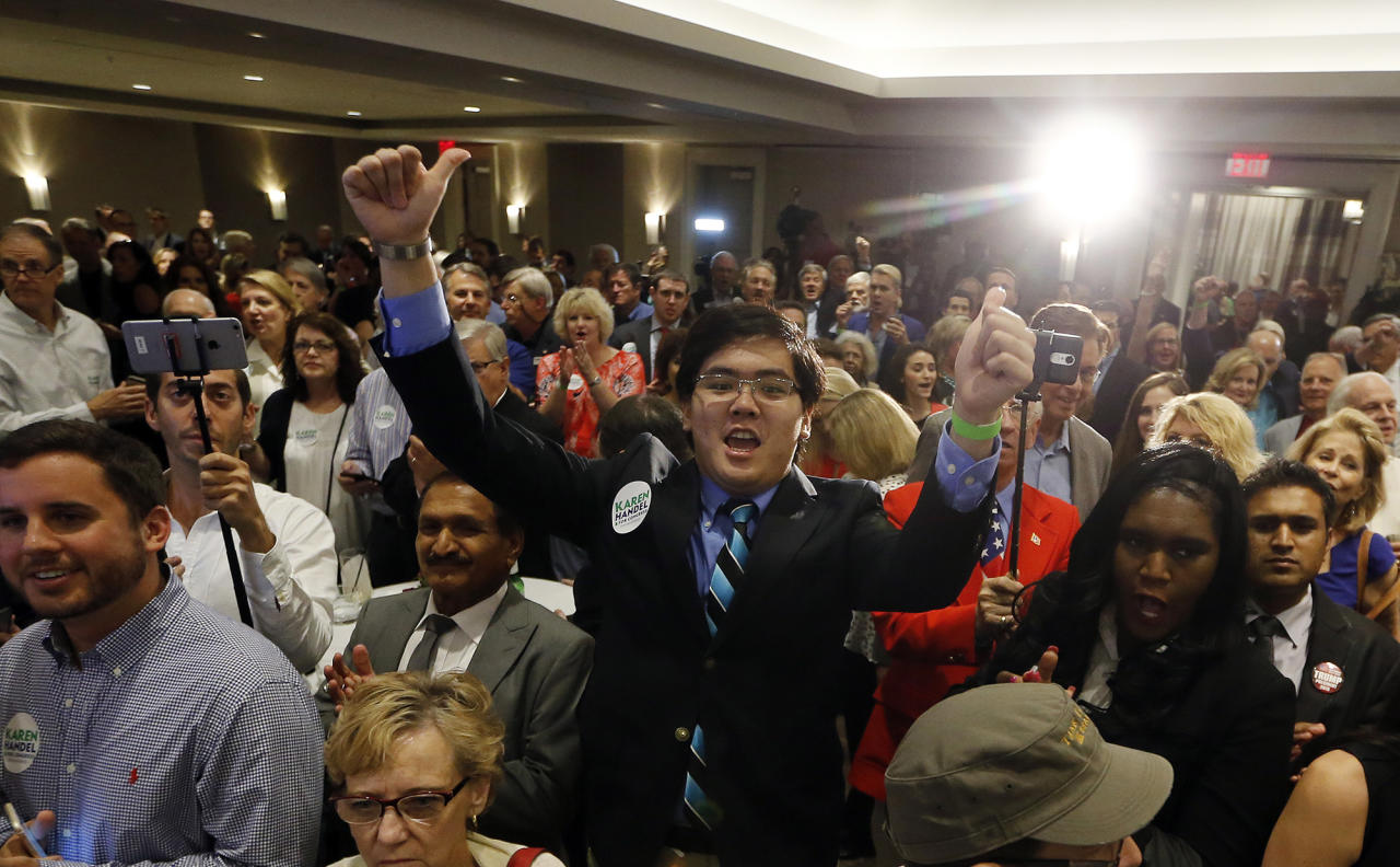 <p>Supporters react as election results for Republican candidate for Georgia's 6th Congressional District seat Karen Handel are shown on a television during an election-night watch party Tuesday, June 20, 2017, in Atlanta. (Photo: John Bazemore/AP) </p>