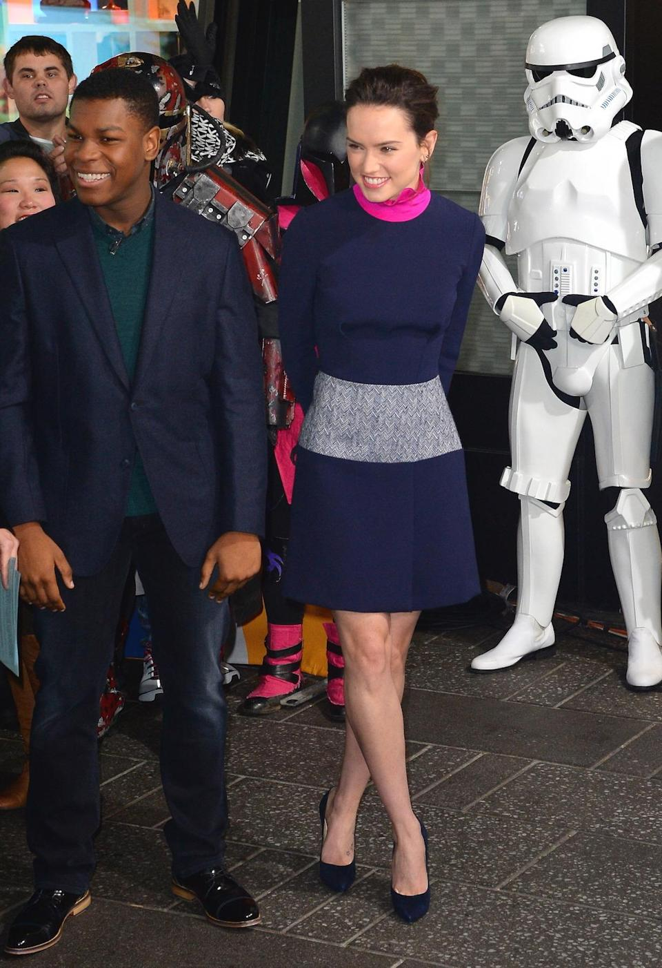<p>Ridley's navy, grey, and shocking pink dress brought the most color to her tour so far.</p><p><i>(Photo: Getty Images)</i></p>