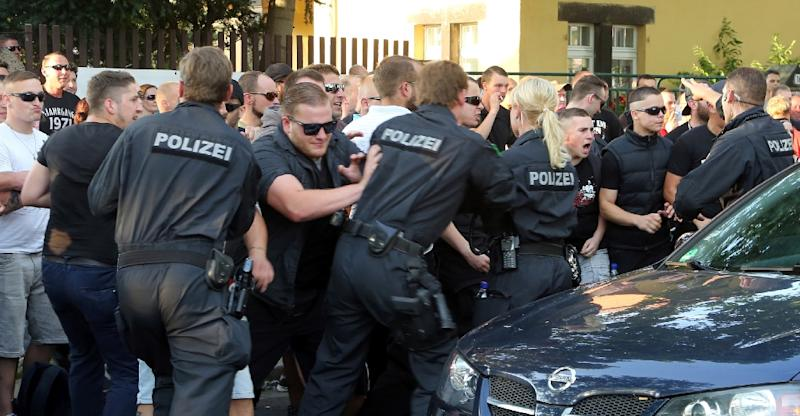 Members of the German far-right party NPD scuffle with police during a demonstration against the arrival of refugees on July 24, 2015 in Dresden, eastern Germany (AFP Photo/Roland Halkasch)