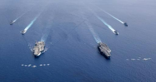 US aircraft carriers the USS Nimitz and USS Ronald Reagan sailing in Asia in July