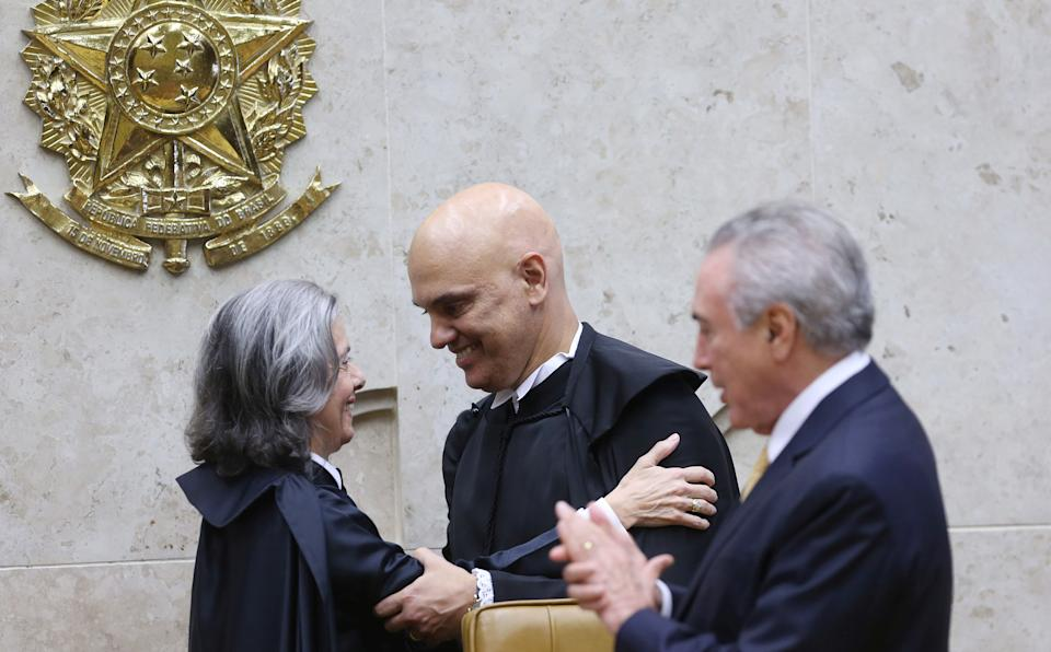 Judge Alexandre de Moraes (C) is greeted by Supreme Court President Carmen Lucia (L) after he was nominated to the Supreme Court by Brazil's President Michel Temer in Brasilia, Brazil, March 22, 2017. REUTERS/Adriano Machado