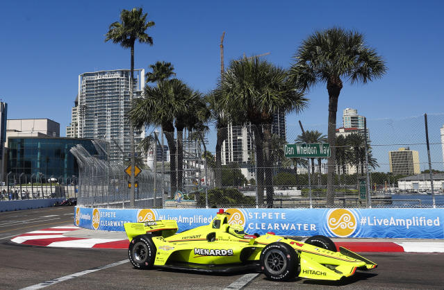 FILE - In this March 9, 2018, file photo, the City of St. Petersburg is pictured in the background as IndyCar driver Simon Pagenaud makes his way through turn 10 during the first IndyCar practice for the Firestone Grand Prix of St. Petersburg, Fla. IndyCar plans to crown its champion on the streets of St. Petersburg, Florida, as the original opener has been rescheduled to Oct. 25 as the finale. (Dirk Shadd/The Tampa Bay Times via AP, File)