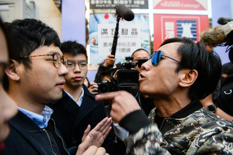 Activist Nathan Law -- shown here (L) being shouted at by another man in Hong Kong in 2018 -- said he has fled the city