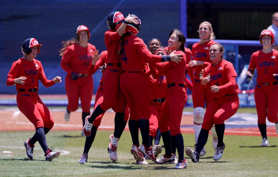 USA's softball players celebrate their walk-off victory during the extra eighth inning of the Tokyo 2020 Olympic Games softball opening round game between Australia and USA at Yokohama Baseball Stadium in Yokohama, Japan, on July 25, 2021. (Photo by KAZUHIRO FUJIHARA / AFP) (Photo by KAZUHIRO FUJIHARA/AFP via Getty Images)