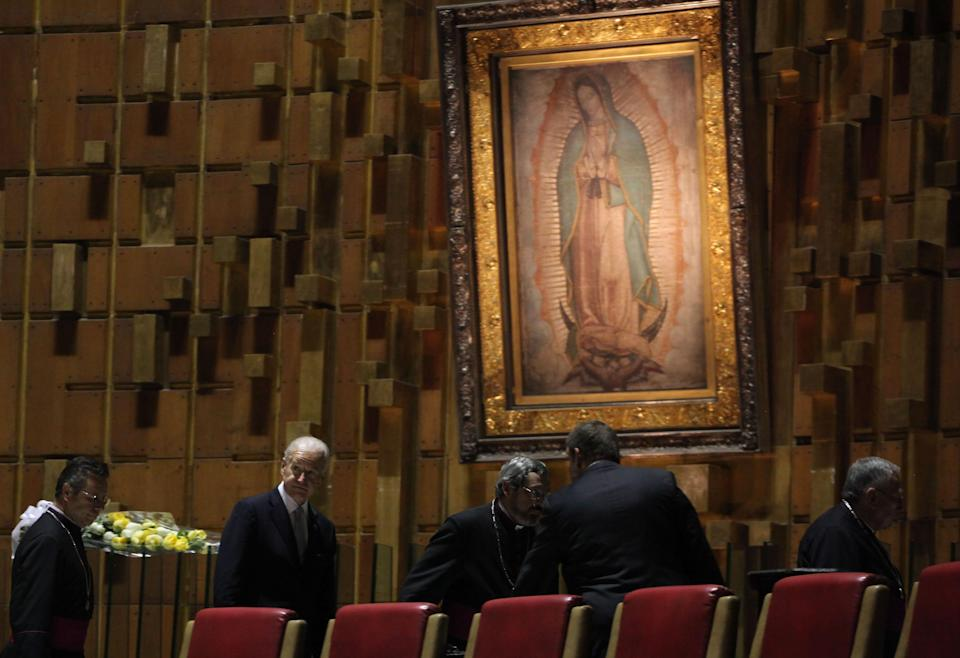 Then-Vice President Joe Biden leaves after placing a flower arrangement under an image of the Virgin of Guadalupe during a visit to the Basilica of Guadalupe in Mexico City, Monday, March 5, 2012. Biden is on a one-day official visit to Mexico. (AP Photo/Alexandre Meneghini)