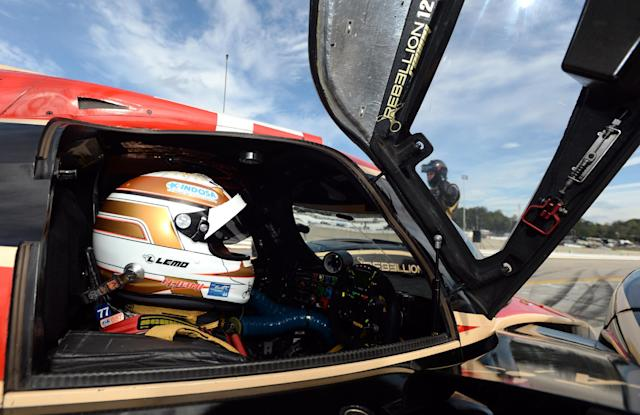 Neel Jani, of Switzerland, sits in the Rebellion Racing Lola B12/60 before qualifying for the American Le Mans Series' Petit Le Mans auto race at Road Atlanta, Friday, Oct. 18, 2013, in Braselton, Ga. (AP Photo/Rainier Ehrhardt)