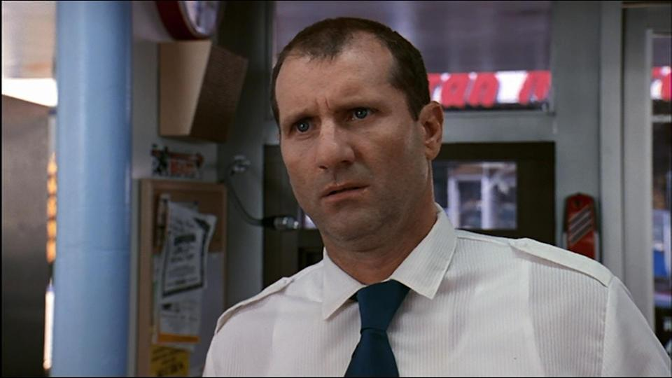 """<p>Ed O'Neill's coffee shop owner Glenn is a gloomy dark spot in the middle of an otherwise light movie and reveals he's happy that Wayne is putting on a concert. """"People need to be entertained, they need the distraction. I wish to God that someone would be able to block out the voices in my head for five minutes, the voices that scream, over and over again: """"Why do they come to me to die? Why do they come to me to die?"""" Fun times. (Credit: Paramount Pictures) </p>"""